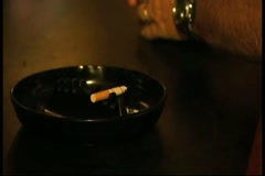 Light Being Pushed to Hand Moving Ash Tray Stock Footage