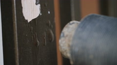 Close up of paint being blowtorched and stripped during redecorating Stock Footage