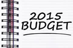 2015 budget words on spring white note book - stock photo