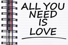 All you need is love words on spring white note book Stock Photos