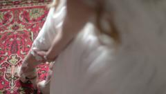 Bride puts on her wedding shoes Stock Footage
