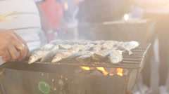Sardines on grill getting fried Stock Footage