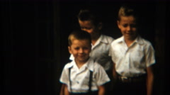 1954: Cute baby brothers dress in white shirts and black pants. Stock Footage