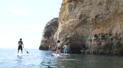 Group of people on water board in Algarve Stock Footage