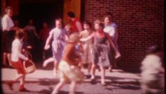 2926 - children let out of school for Easter Egg hunt - vintage film home movie Stock Footage