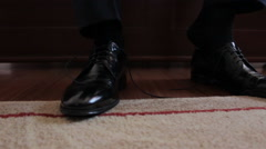 Man puts on shoes. Stock Footage