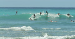 People surfing in Waikiki beach Hawaii Stock Footage