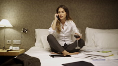 Business woman in hotel room relaxing Stock Footage
