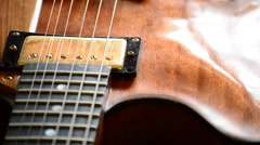 Luthier working in a electric guitar in workplace Stock Footage
