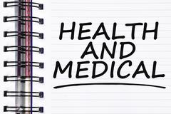 Health and medical words on spring white note book Stock Photos