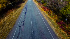 Flying Over a Highway in Autumn. Videography Quadrocopters Stock Footage
