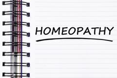 Homeopathy words on spring note book Stock Photos