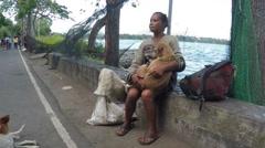 Homeless woman cuddling a dog Stock Footage