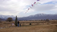 A little boy and grandpa flying kite in cold winter wind Stock Footage