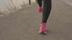 Closeup Runner women's running seaside. athlete fitness silhouette sunrise Stock Footage