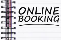 Online booking words on spring white note book Stock Photos