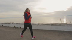 Runner woman running seaside. athlete fitness silhouette sunrise jogging workout - stock footage