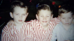 1955: Christmas morning sleepy brothers get excited about the holiday. Stock Footage
