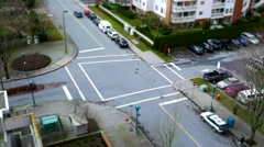 Top shot of four way traffic flow and pedestrians crossing the street with mi - stock footage