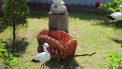 Fairy figurines on the lawn near the house.   NTSC. Stock Footage