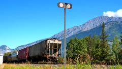 4K Close Up Pan of Cargo Cars and End of Freight Train in Mountains Stock Footage