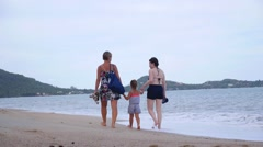 Same-sex Female Family with Child Walking on Beach Stock Footage