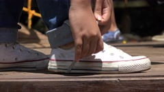 Female Tying White Sneakers Stock Footage