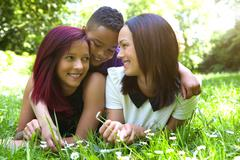 Two females smiling with little boy Stock Photos