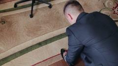 Man tying shoelaces.NTSC Stock Footage