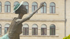 Woman with hat statue at Cristian Pațurcă Monument in Bucharest Stock Footage