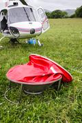 Monsoon bucket with helicopter. Stock Photos