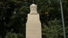 Bogdan Petriceicu Hasdeu bust statue in Cismigiu Gardens, Bucharest Stock Footage