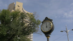 Vintage street clock near Intercontinental Hotel in Bucharest - stock footage