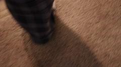 Gimbal low shot of man walking down stairs Stock Footage
