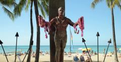 Duke Kahanamoku statue on Waikiki beach Stock Footage