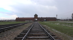 Auschwitz - Birkenau concentration camp main gate rail - Poland Stock Footage