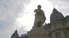 Low angle view of Gheorghe Lazar statue in Bucharest Stock Footage