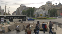 Cars and people walking by the University metro station in Bucharest Stock Footage