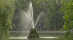 Beautiful fountain with green moss in a lake Bucharest Stock Footage