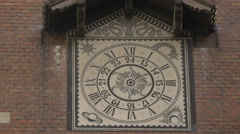 Unique clock on a brick building in Bucharest Stock Footage
