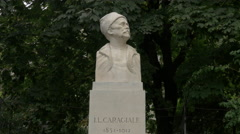 Ion Luca Caragiale bust statue in Cismigiu gardens, Bucharest - stock footage