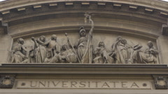 The University of Bucharest frieze with statues Stock Footage