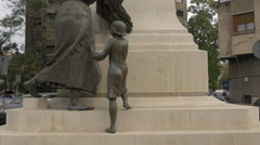 Woman and child statues standing near Lascăr Catargiu statue in Bucharest Stock Footage
