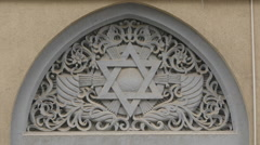 The Star of David above the front door of Yeshua Tova Synagogue in Bucharest Stock Footage