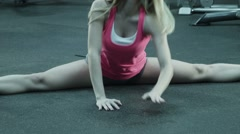The girl does fitness exercise for body stretching Stock Footage