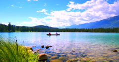 4K Canoe Paddles with Sky Reflection on Beautiful Lake in Alpine Mountain Forest Stock Footage
