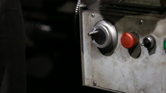 Operator turns the handle to move the cutter Stock Footage