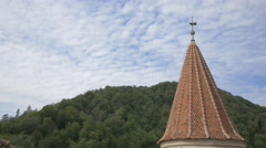 Round tower with conical roof at Bran Castle - stock footage