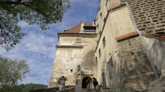Taking pictures at Bran Castle's entrance Stock Footage