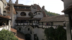 Tourists admiring the Bran Castle's courtyard Stock Footage